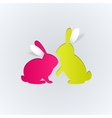 Couple of paper rabbits on a white background vector image vector image