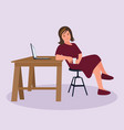 a tired woman at home at table with laptop vector image