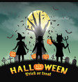 halloween kids in front devil hand in graveyard vector image vector image