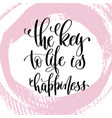 key to life is happiness hand written vector image vector image