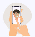 hand holding mobile smart phone with face vector image