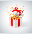 White gift box with red ribbon and golden confetti