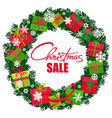 christmas sale poster wreath with gift boxes and vector image vector image