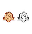 hunting badge with dog head on shield vector image vector image