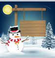 snowman with wood board sign on night winter lake vector image vector image