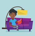 young african woman reading a book on sofa vector image vector image