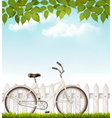 bicycle in front a white fence with green vector image