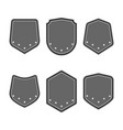 set of black shields with stars in trendy flat vector image