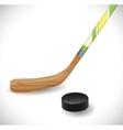 Hockey stick and hockey puck vector image vector image