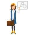 Business woman pointing at cogwheels