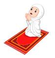 muslim girl sitting on the prayer rug while prayin vector image vector image