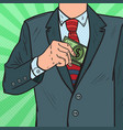 pop art businessman putting money in suit pocket vector image