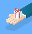 hand holding gift box vector image