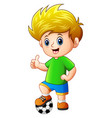 little boy with soccer ball vector image