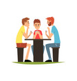 friends playing cards sitting at the table men vector image
