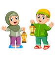 moslem kids holding lantern vector image vector image