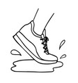 sneakers running through puddle vector image