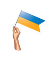 ukraine flag and hand on white background vector image