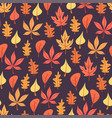 autumn leaves pattern on dark background vector image