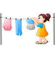 cartoon little girl hanging clothes vector image