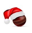 cricket ball with santa claus hat vector image vector image