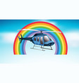 helicopter flying in blue sky with rainbow vector image vector image
