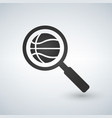 magnifying glass with basketball ball icon vector image vector image