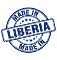 made in liberia blue grunge round stamp vector image vector image