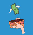 dollars with wings flying away from hand vector image vector image