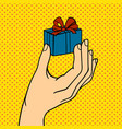 pop art hand with gift box vector image vector image