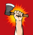 male hand holding axe in the air vector image vector image