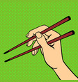 pop art hand with sushi chopsticks vector image vector image