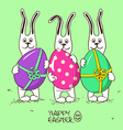 Three bunny rabbits holding Easter eggs vector image vector image