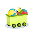 small green wagon full of children toys vector image