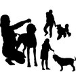 set silhouette people with dogs vector image vector image