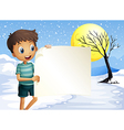 A boy smiling holding an empty signage vector image vector image