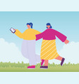 two friendly girl with smartphone walking in vector image