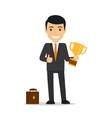 Businessman holding trophy vector image
