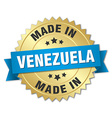 made in Venezuela gold badge with blue ribbon vector image vector image