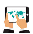 the tablet in the hands of a map of the earth vector image vector image