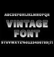 vintage dotted sans serif font on black background vector image