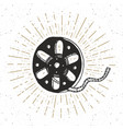 cinema tape and film reel vintage label hand vector image