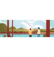 father and son fishing together rear view man vector image vector image