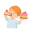 cute little boy eating creamy cake with strawberry vector image vector image