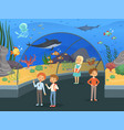 kids in aquarium family walk threw underwater vector image