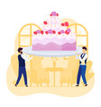 tiny waiters people carrying huge wedding cake to vector image vector image