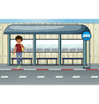 A boy at the bus stop vector image vector image