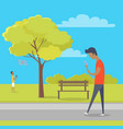 boy with smartphone on walk in park out of town vector image vector image