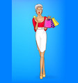 girl holds credit card bags shopping vector image