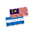 flags honduras and malaysia on a white vector image